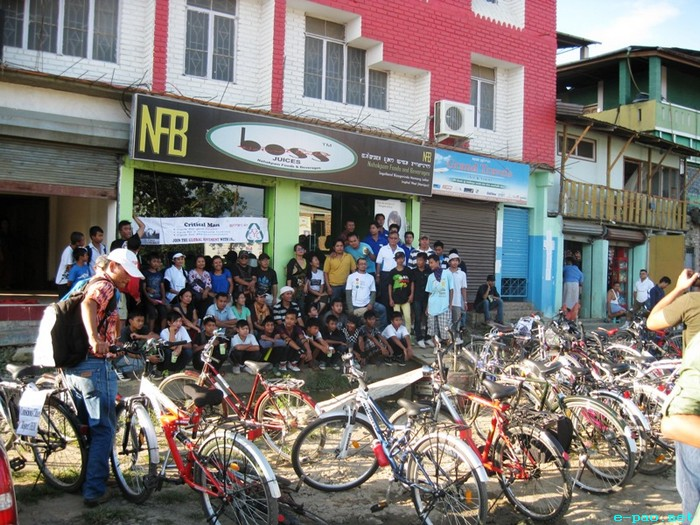Fifth Critical Mass of cycle enthusiast cycling together on the streets of Imphal