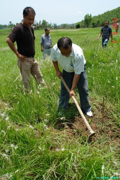 Planting a tree during World Environment Day 2012 function at IBSD Bioresources Park, Haraorou, Imphal on June 5 2012