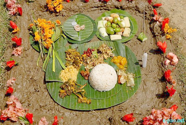Preparation of food, cooking , offerings to God and eating together - all as part of Sajibu Nongma Panba Chiraoba in Imphal on April 04 2011.