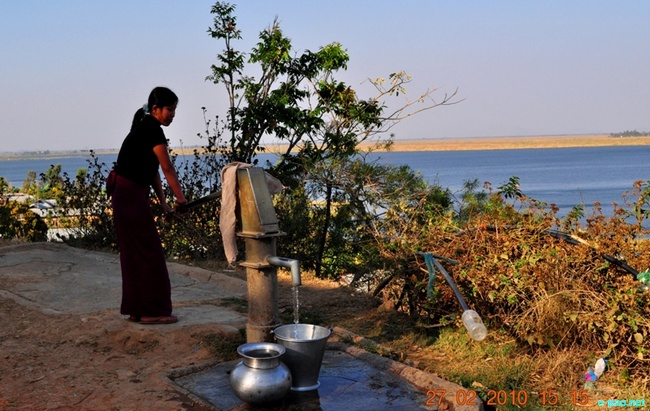 Collecting water from a Hand pump near  Loktak Lake :: Februray 2010
