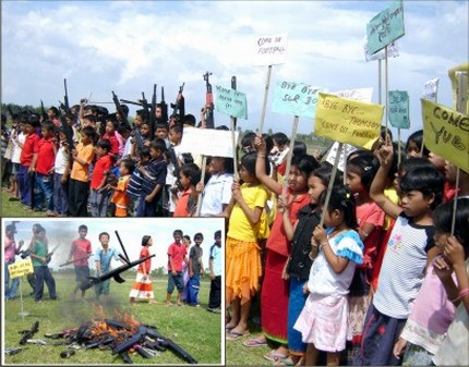 Children hand over their favourite toys before the toy guns were consigned to flames to highlight criminal activities in Manipur