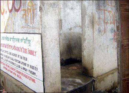 An unkempt public toilet for women at a market place