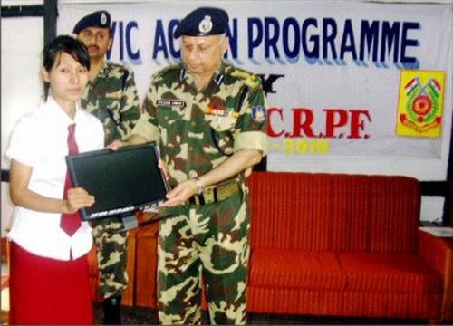 Helping hand from 143 CRPF : A student being presented a gift in August 2010