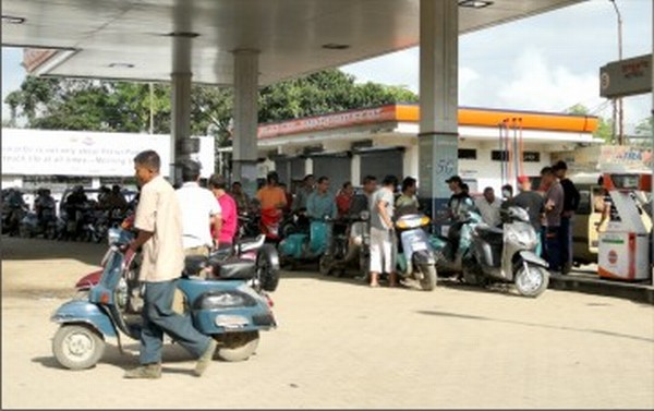 Vehicles line up in front of a fuel outlet to get their ration