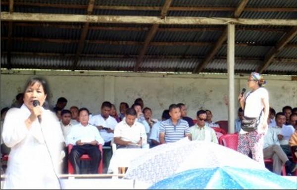 Kim Gangte addresses the public meeting
