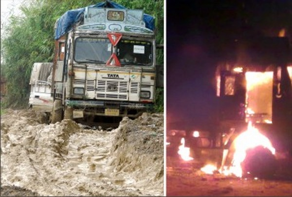 Trucks negotiate its way through NH-37 and the smouldering truck on NH-2