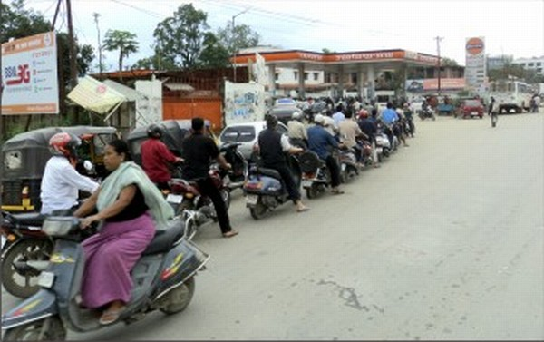 With the supply lines cut off, long queue at a petrol pump