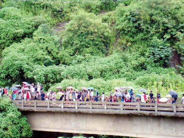 Bandh supporters blocking NH 39 at Kangpokpi bridge