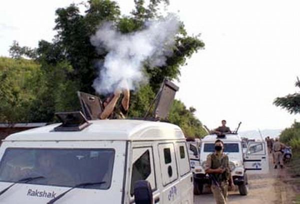Police firing tear gas to disperse anti-counter blockade agitators at Kakching Lamkhai