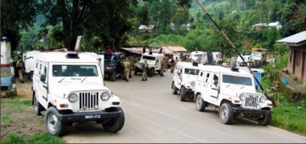 Security personnel getting ready to escort vehicles on NH-37