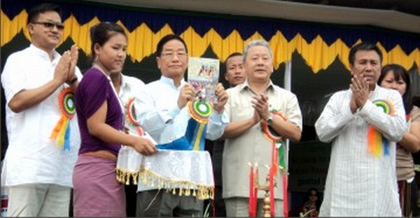 Horticulture Minister P Tonsing releases a souvenir while inaugurating the Pineapple Festival