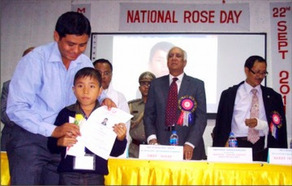 Master Th Sanathoi with the Rose he was gifted by Governor