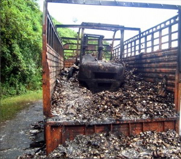 Charred remains of truck at a Sadar Hills area