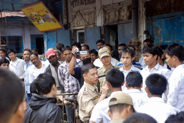 City Police personnel trying to prevent students from shutting down shops at Thangal bazar