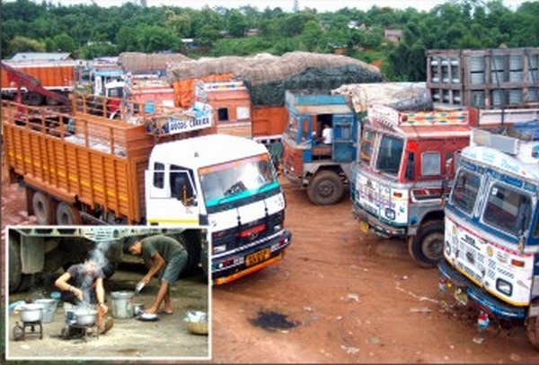 Trucks stranded along National Highway-39 and (inset) an assistant preparing meal in the open