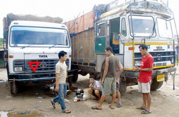 Stranded truck drivers and handymen getting ready to prepare a meal