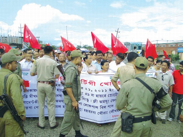 CPI cadres who were staging a protest march being stopped by the police