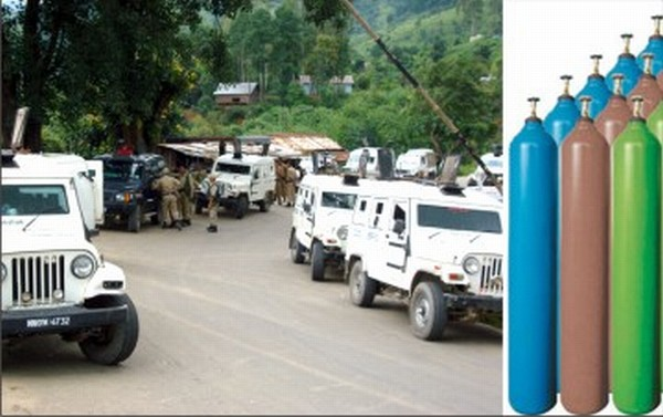 Security escorts get ready for the NH-37 route and medical oxygen cylinders