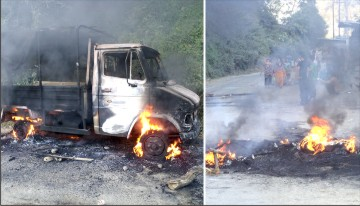 One of the Tata Sumo burnt by bandh enforcers and bandh being enforced on NH-37