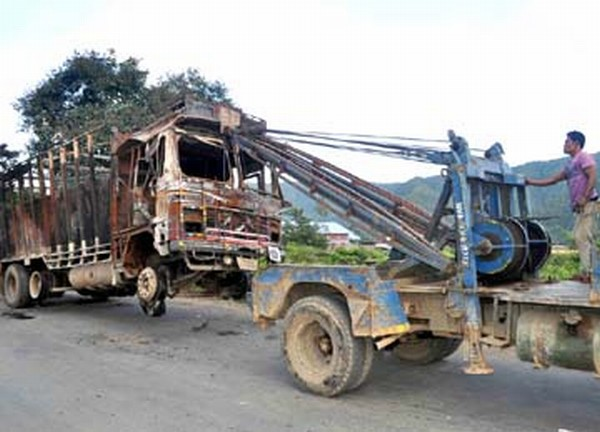 Wrecked truck being towed away