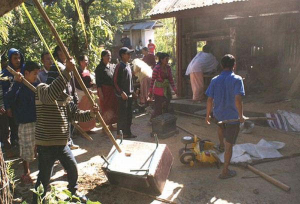 Angry mob ransacking the house of Niranjan who allegedly beat his wife to death November 26 2011