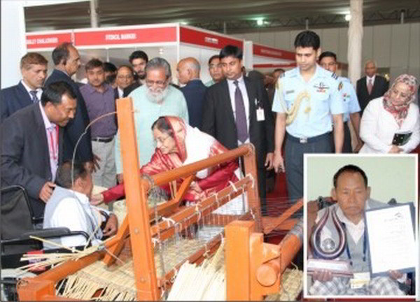 Mangi with his machine with the President and inset Mangi