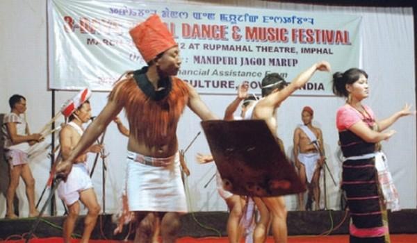 A cultural troupe performing dance at the inaugural of Tribal Dance and Music Festival at Rupmahal Theatre