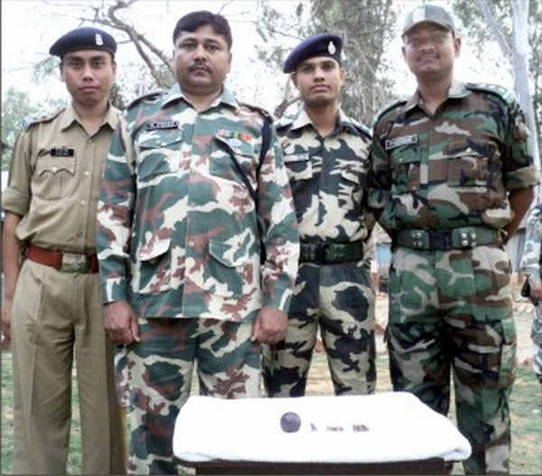 69 Bn CRPF officers/personnel pose with the recoveries