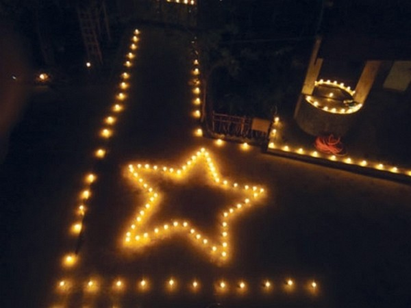 Candles being lit to form Star symbol of RPF on April 13