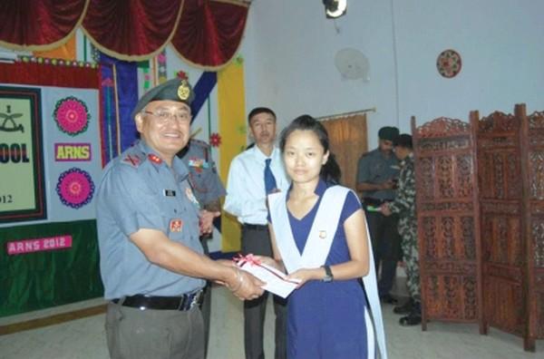 IGAR (S) Maj Gen U K Gurung, felicitating a meritorious student of Assam Rifles Nodal School