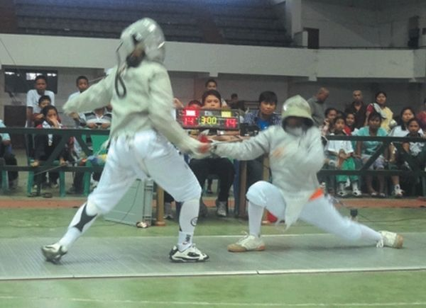 A girls' bout of the 8th Governor's Cup State Level Fencing Championships 2012 at Imphal.