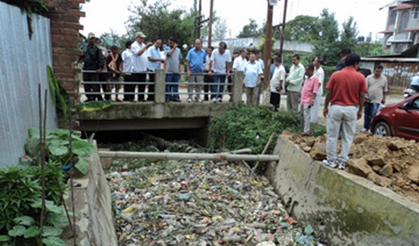 The MLA and his team inspecting a drain