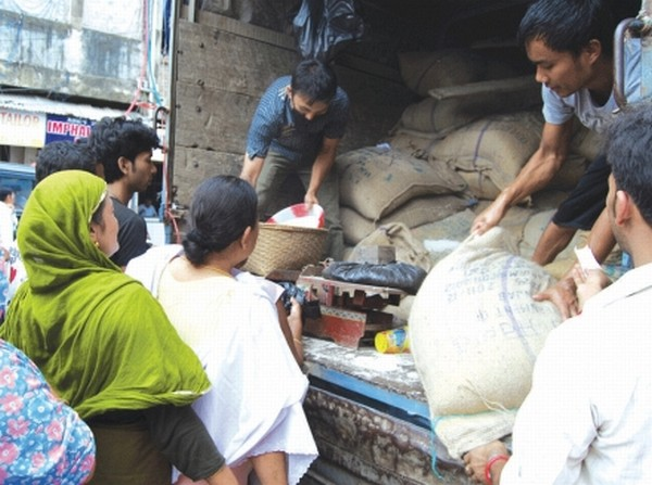 Public waiting for their turn to purchase rice at subsidised rate from one of the mobile outlets
