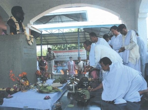 People paying floral tributes to the memorial of Arambam Samarendra at Khurai Salanthong on the occasion of his 12th death anniversary