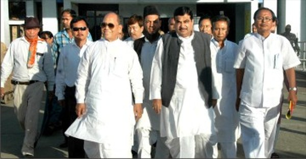 Nitin Gadkari on arrival at the airport and seen with State BJP leaders, including Th Chaoba