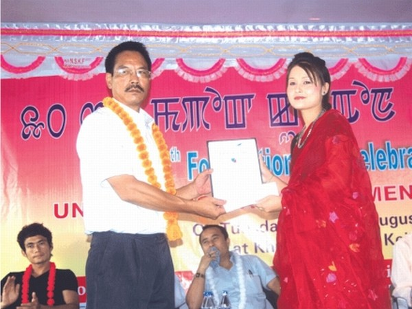 Manipuri film actress Elangbam Abenao being honoured with Th Ashokumar Memorial Award in Arts and Culture on the occasion of 10th foundation day of USU, Khurai