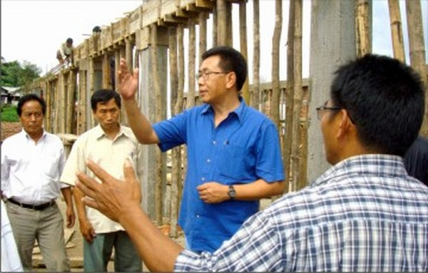 Victor Keishing inspecting a market shed