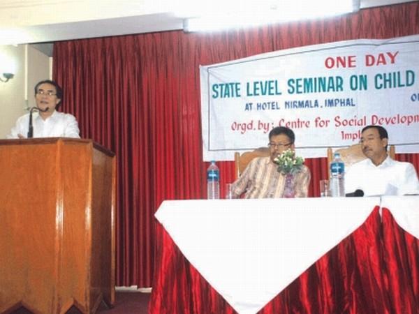 Prof W Nabakumar speaking at the seminar as Arun and Dhanabir look on