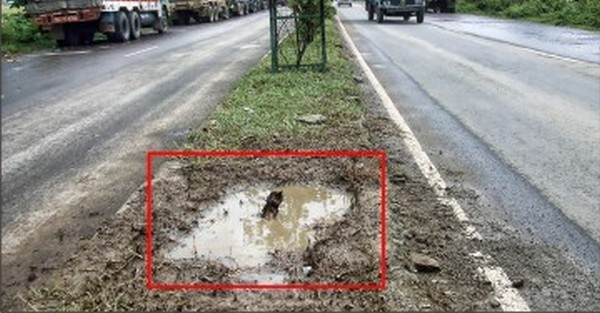 The crater left by the bomb explosion in the middle of NH-2 on Oct 1 2012