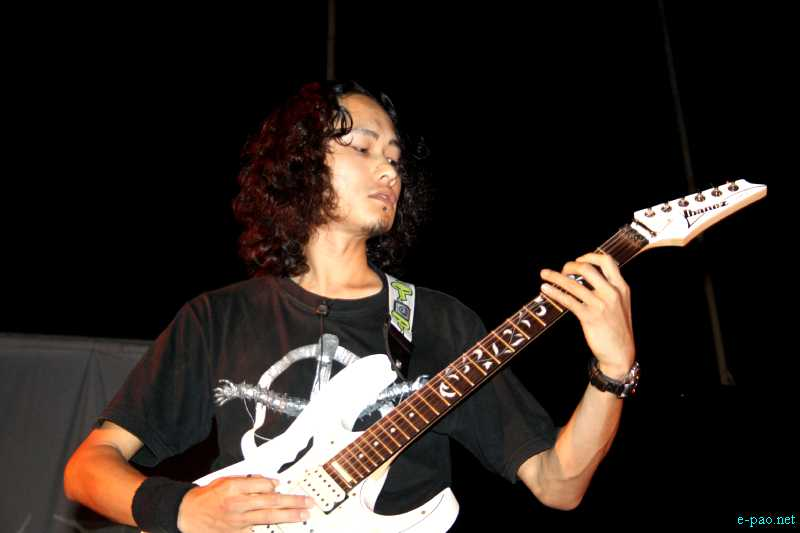 A guitar solo at the  1st Imphal Metal Convention - Metal Age Reloaded - 2012 at YAC Ground (Range) on 14th April 2012