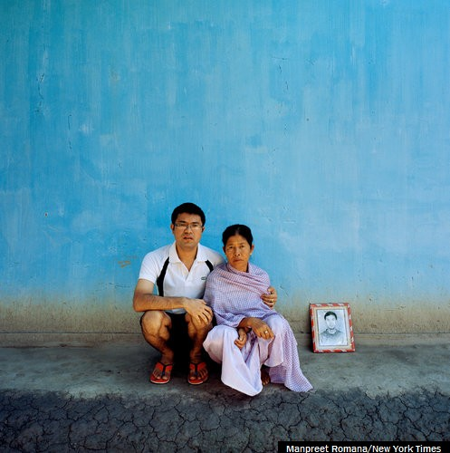 Manichandra Singh with his mother and a picture of one of his brothers, who was killed with nine others on Nov. 2, 2000. The episode prompted Irom Chanu Sharmila's hunger strike. :: Manpreet Romana for The New York Times