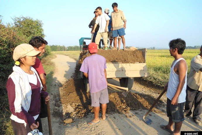 Failure of Government: Volunteers of Khousabung Youth Club in Churachandpur District repairing Dr Kalam Road between Moirang - Bunglon, which was left unattended for years by the Government