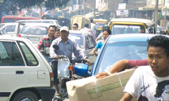 Caught in traffic snarl : In the absence of proper traffic management travelling on the roads of Imphal has become a hellish experience in first week of April 2012